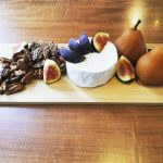 Les Folies Bergères Goat Brie, Chai Poached Pears, Spiced Nuts, Fresh Figs and French Baguette